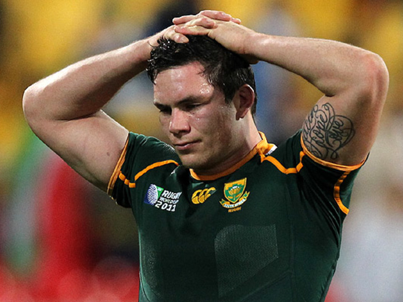 Large francois louw hands on head