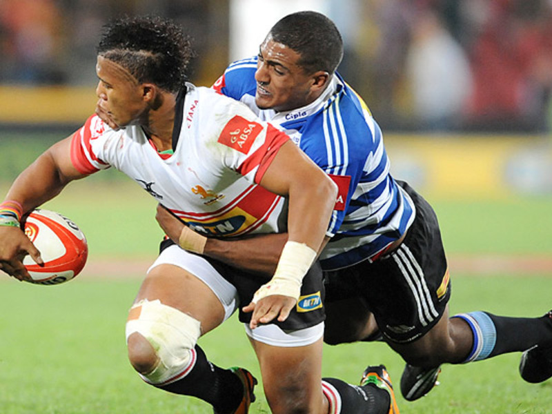 Large elton jantjies tackled by b