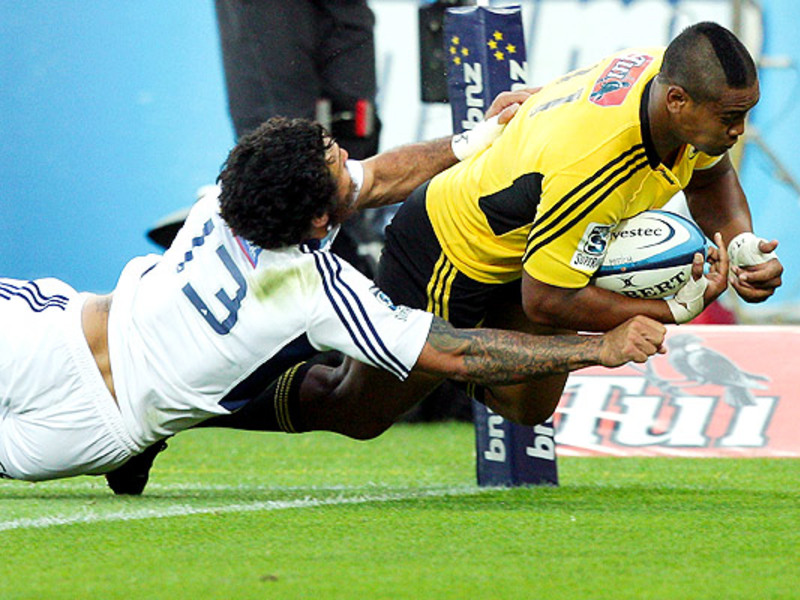 Large julian savea tackled by ren