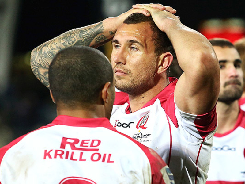Large quade cooper hands on head