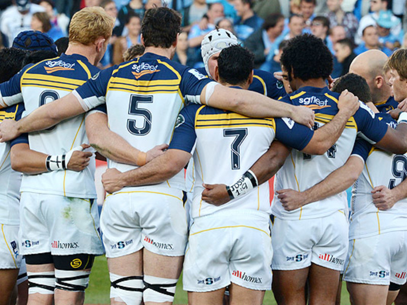 Large brumbies team huddle
