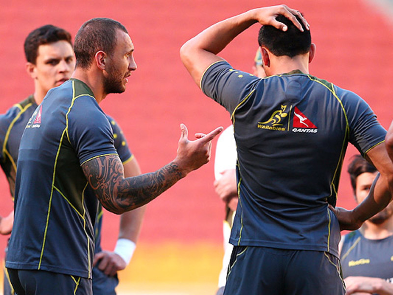 Large quade cooper talks to team