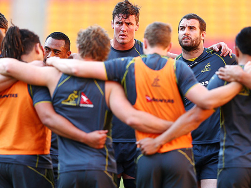 Large wallaby team huddle