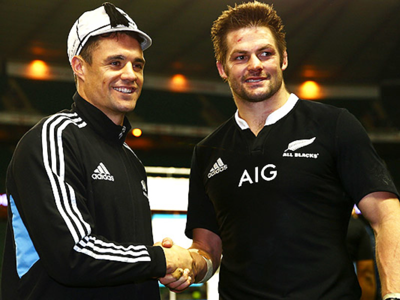 Large dan carter congratulated by