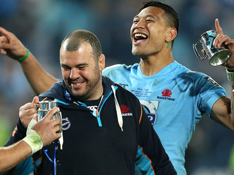 Large michael cheika celebrates