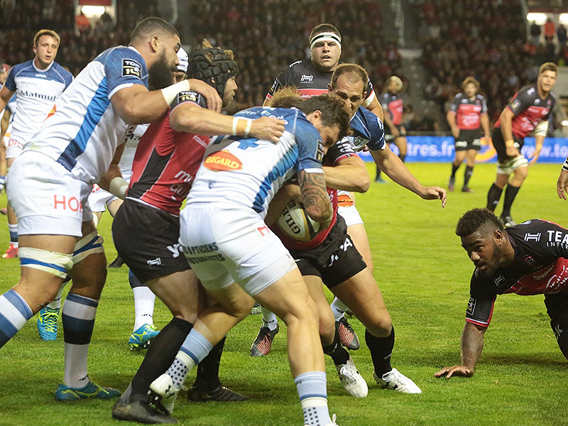 Large toulon player tackled