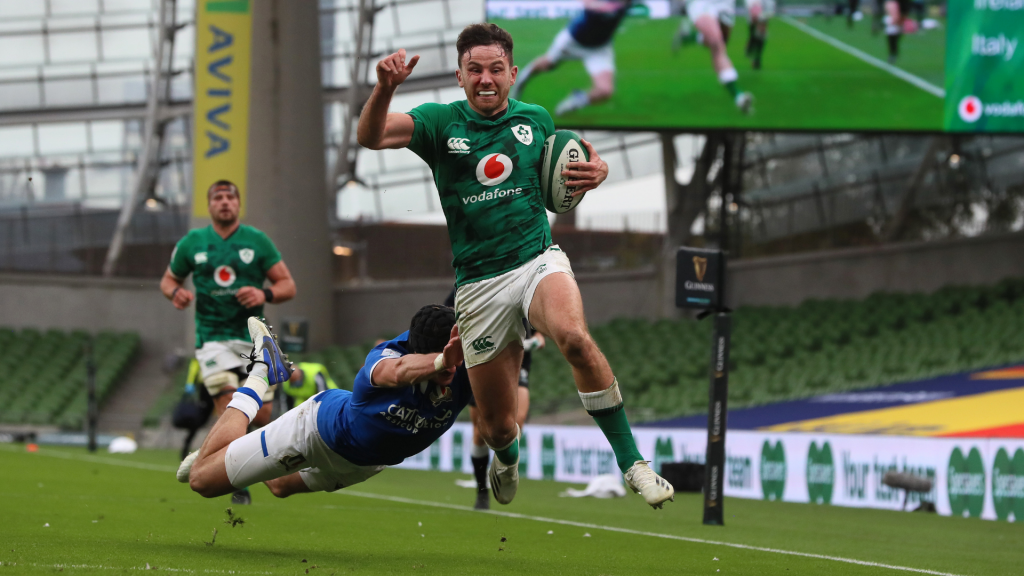 Ireland hammer Italy to go top